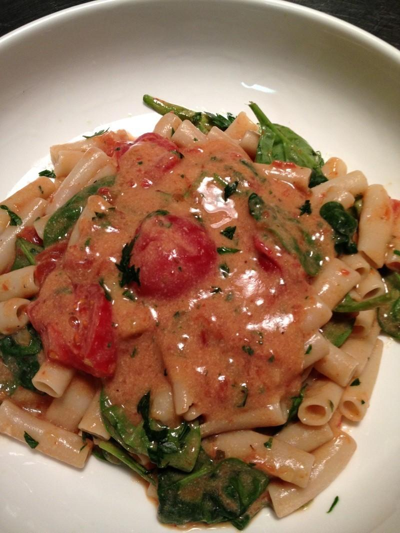 tomato cream sauce over pasta with spinach